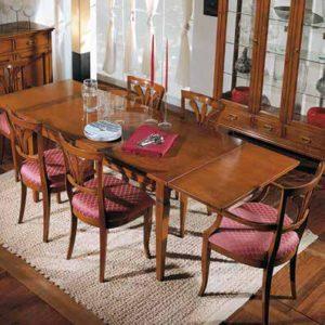 Particolare del tavolo con allunghe aperte